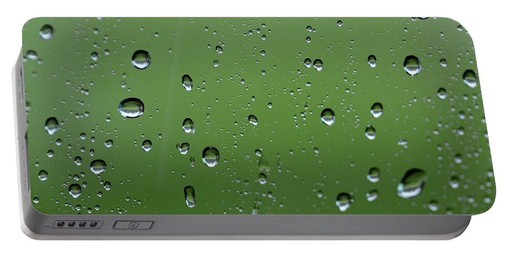 Green Portable Battery Charger featuring the photograph Raindrops 2 by Charles Bacon Jr