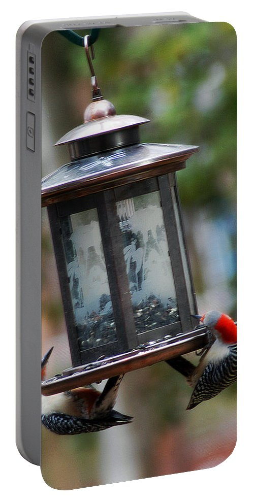 Clay Portable Battery Charger featuring the photograph Red Head Wood Peckers On Feeder by Clayton Bruster