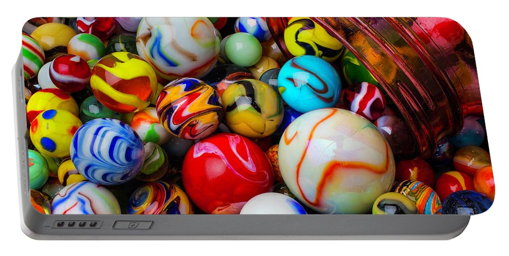 Glass Portable Battery Charger featuring the photograph Red Jar Spilling Marbles by Garry Gay
