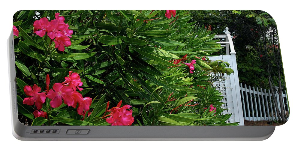 Red Portable Battery Charger featuring the photograph Red Oleander Arbor by Marie Hicks