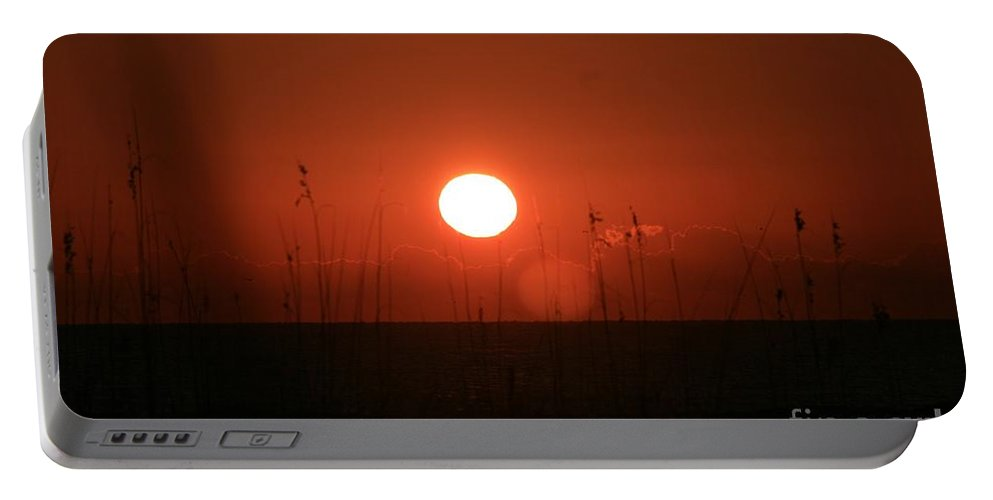 Sunset Portable Battery Charger featuring the photograph Red Sunset And Grasses by Nadine Rippelmeyer