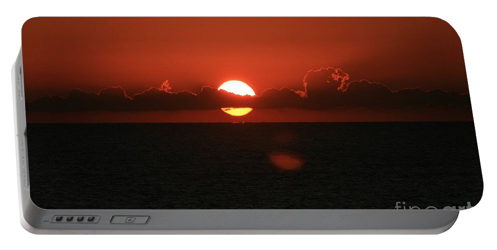 Sunset Portable Battery Charger featuring the photograph Red Sunset Over The Atlantic by Nadine Rippelmeyer