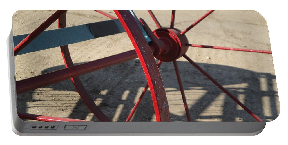 Wheel Portable Battery Charger featuring the photograph Red Waggon Wheel by Susan Baker