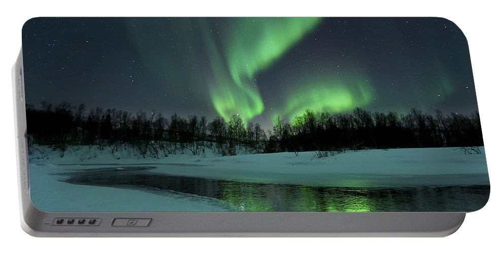 Green Portable Battery Charger featuring the photograph Reflected Aurora Over A Frozen Laksa by Arild Heitmann