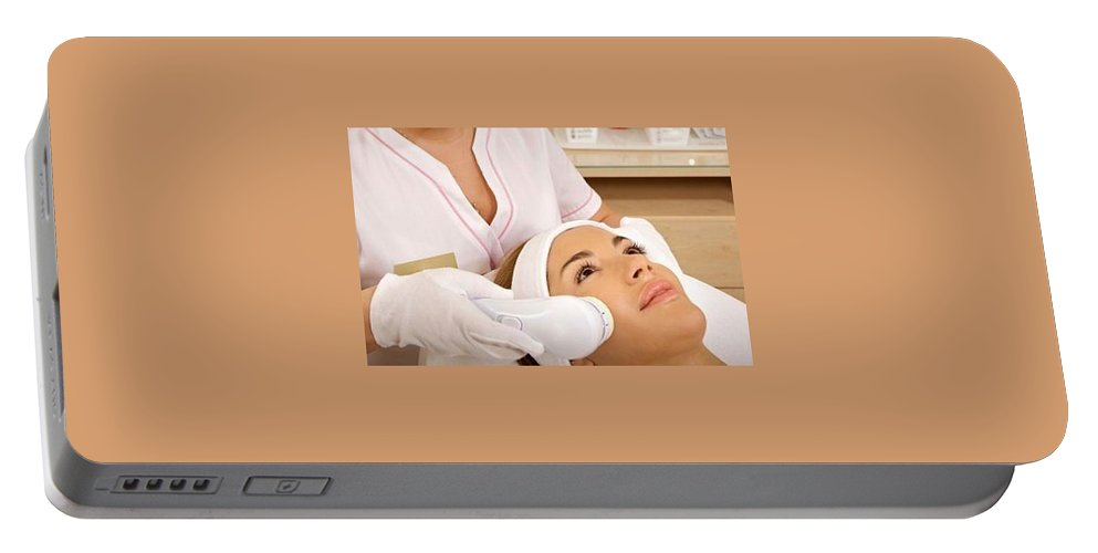 Dermatology Co2 Laser Portable Battery Charger featuring the pyrography Rejuvenate Skin Through Dermatology Co2 Laser by Laser