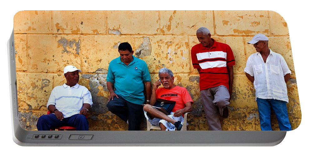 Senior Portable Battery Charger featuring the photograph Retired Men And Yellow Wall Cartegena by Thomas Marchessault