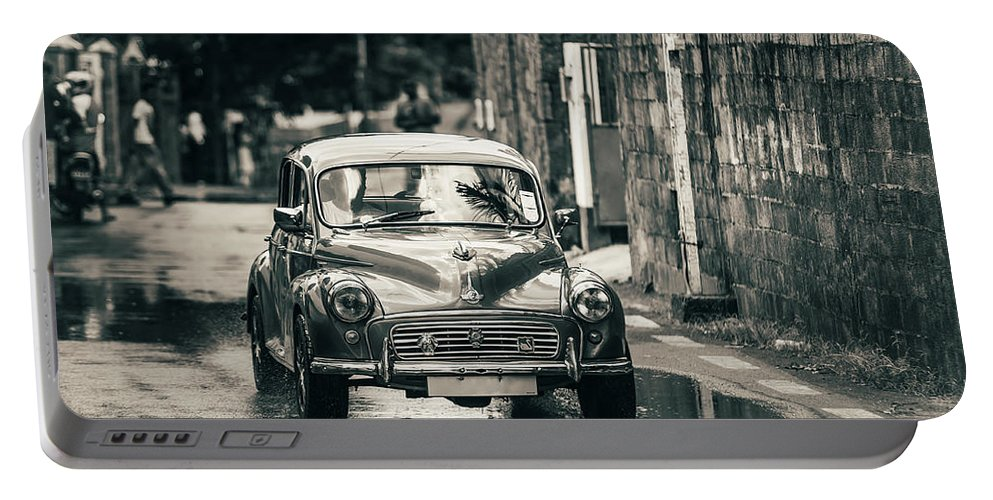 Morris Minor Portable Battery Charger featuring the photograph Retromobile. Morris Minor. Vintage Monochrome by Jenny Rainbow