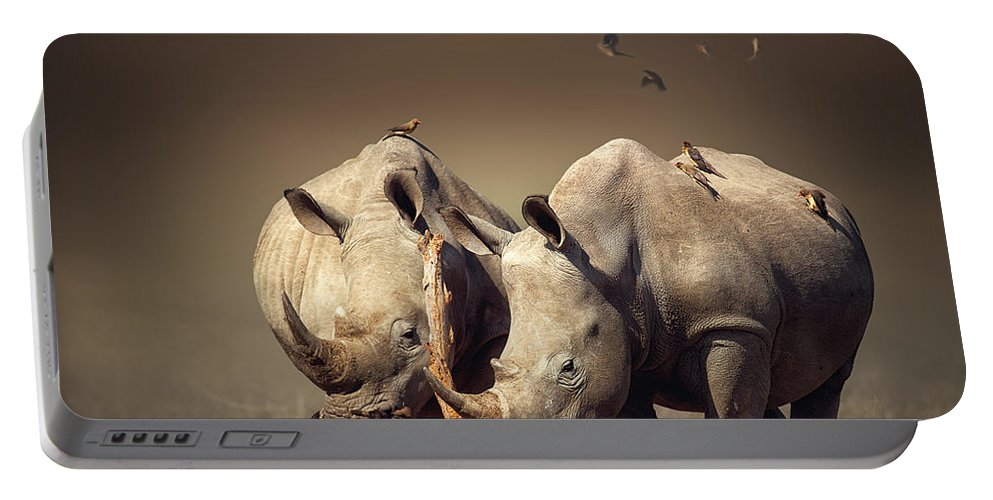 Rhinoceros Portable Battery Charger featuring the photograph Rhino's With Birds by Johan Swanepoel