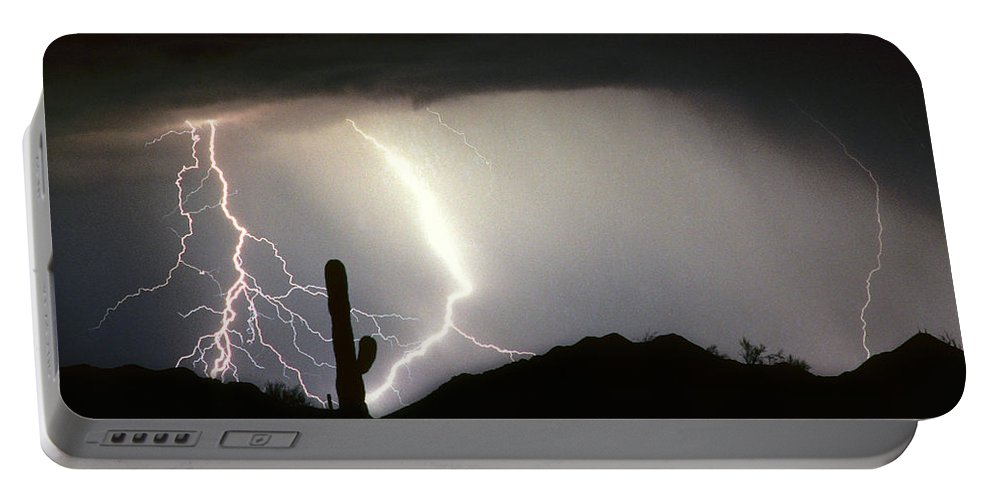 Lightning Portable Battery Charger featuring the photograph Ridin The Southwest Desert Storm Out by James BO Insogna