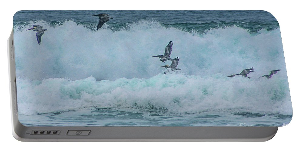 Vandenberg Portable Battery Charger featuring the photograph Riding The Waves At Wall Beach by Tommy Anderson