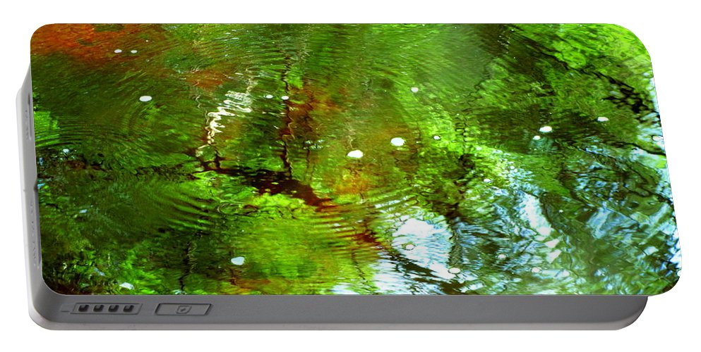 Water Portable Battery Charger featuring the photograph Ripple Effects by Sybil Staples