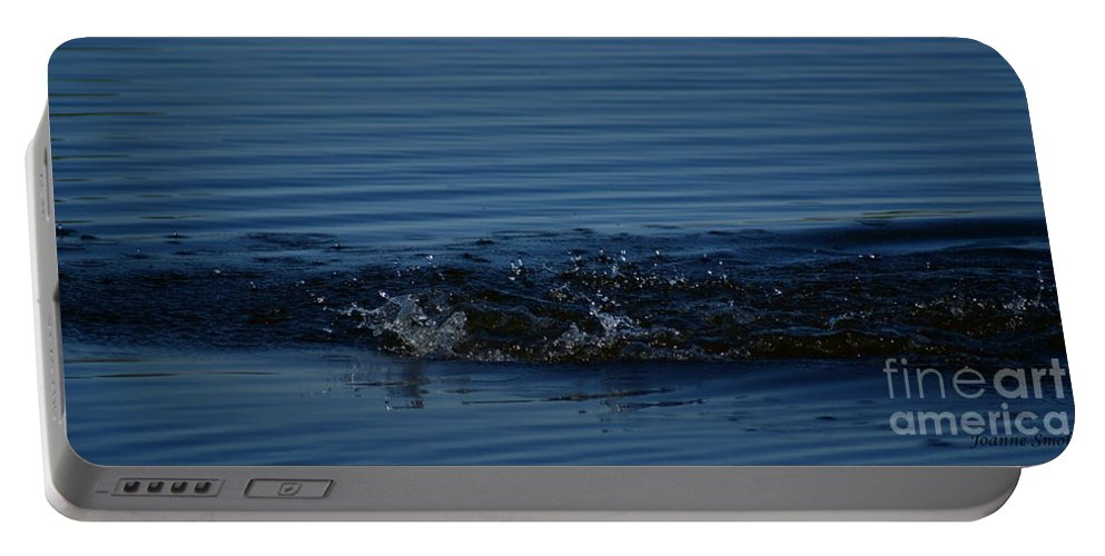 Waves Ripples In Lake Portable Battery Charger featuring the photograph Ripples by Joanne Smoley