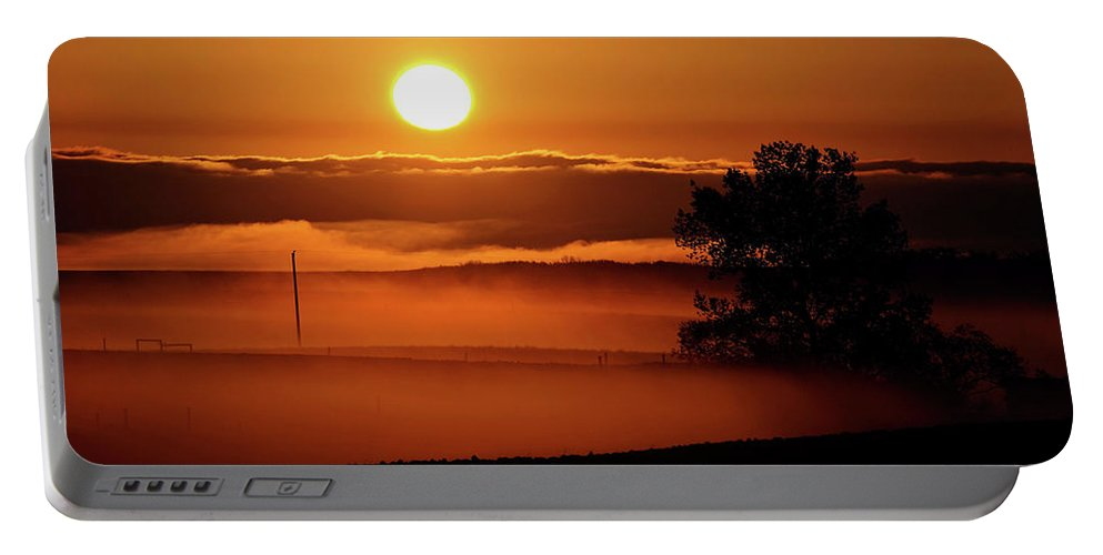 Portable Battery Charger featuring the digital art Rising Sun Lighting Ground Fog by Mark Duffy