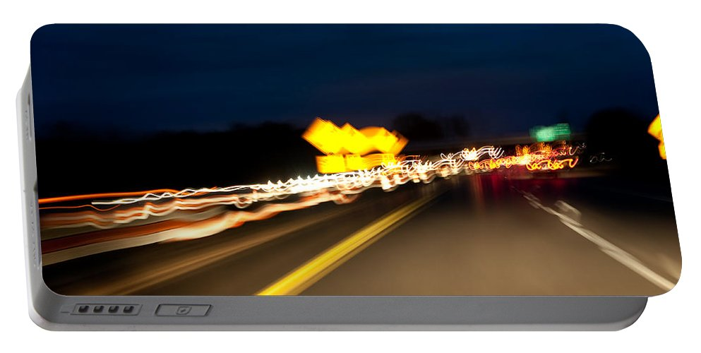 Freeway Portable Battery Charger featuring the photograph Road At Night 1 by Steven Dunn