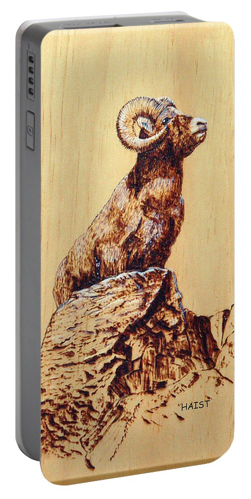 Ram Portable Battery Charger featuring the pyrography Rocky Mountain Bighorn Sheep by Ron Haist