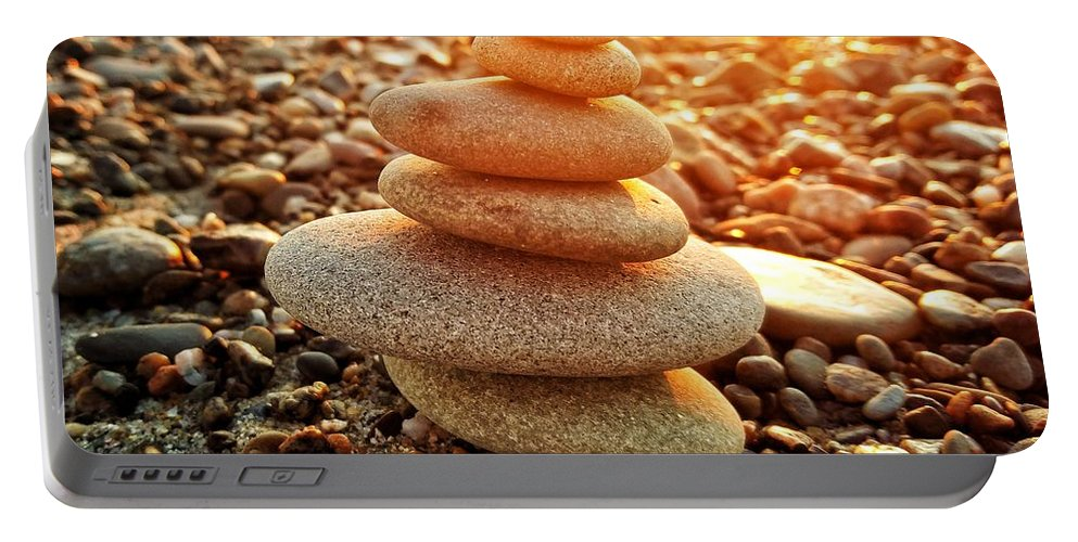 Rocks Portable Battery Charger featuring the photograph Rocky Sunset by Michael Bearden