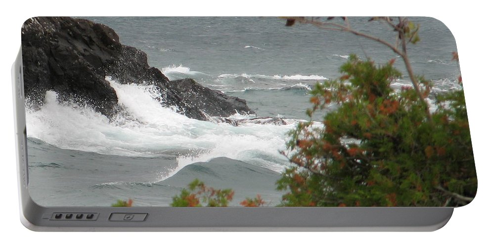 Waves Portable Battery Charger featuring the photograph Rolling Storm by Kelly Mezzapelle