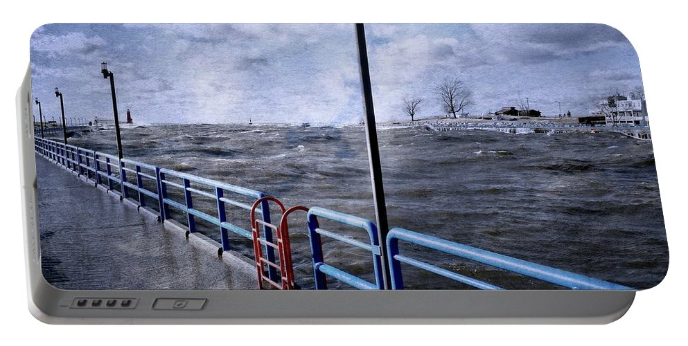 Lighthouse Portable Battery Charger featuring the photograph Rolling Waves In Winter At Grand Haven by Michelle Calkins