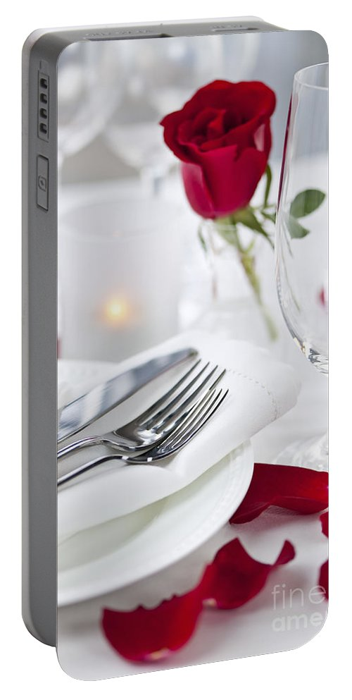 Romantic Portable Battery Charger featuring the photograph Romantic Dinner Setting With Rose Petals by Elena Elisseeva