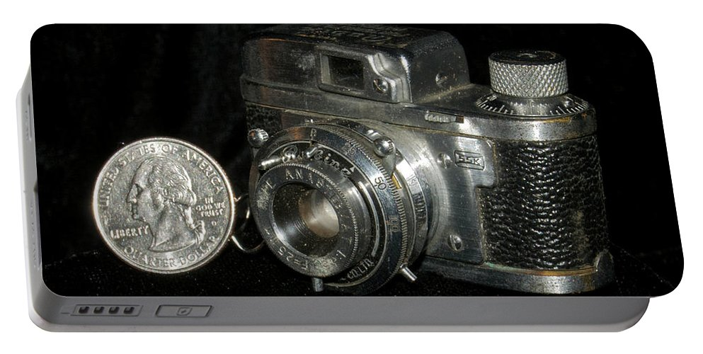 Rubix Portable Battery Charger featuring the photograph Rubix 16mm Film 1949 by Michael Peychich