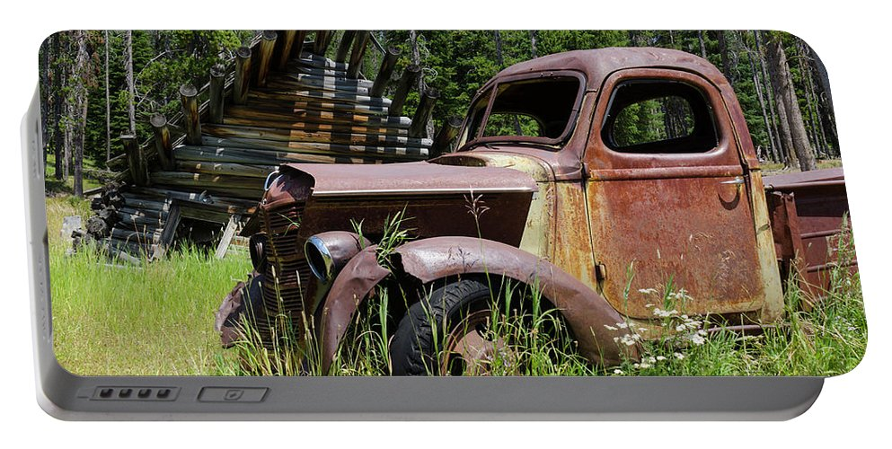 Rust Portable Battery Charger featuring the photograph Rusted Truck by Kevin Gallagher