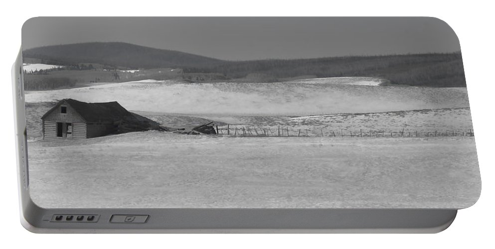 Cabin Portable Battery Charger featuring the photograph Rustic Cabin In The Snow by Don Schwartz