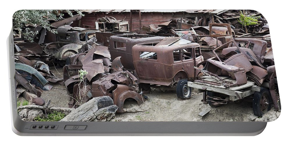 Classic Cars Portable Battery Charger featuring the photograph Rusting Antique Cars by Inga Spence