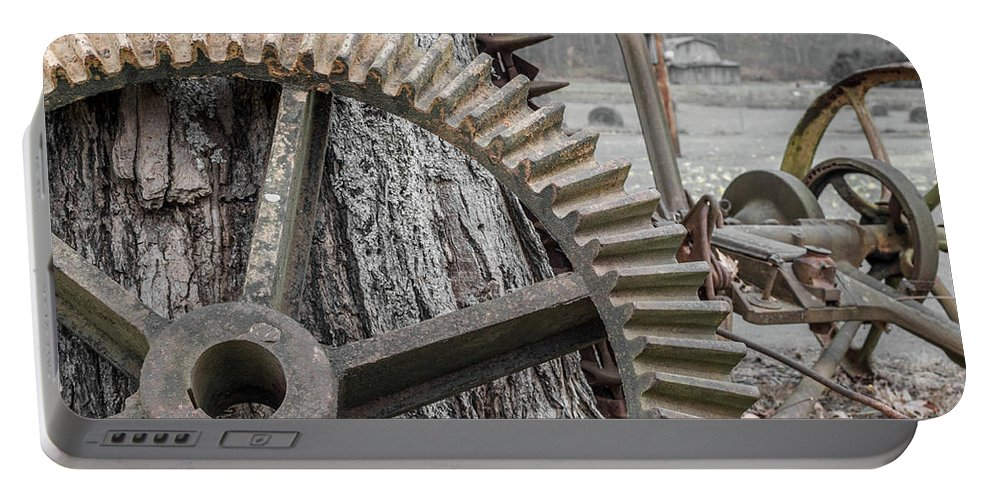 Farm Life Portable Battery Charger featuring the photograph Rusty Cog by Jim Love