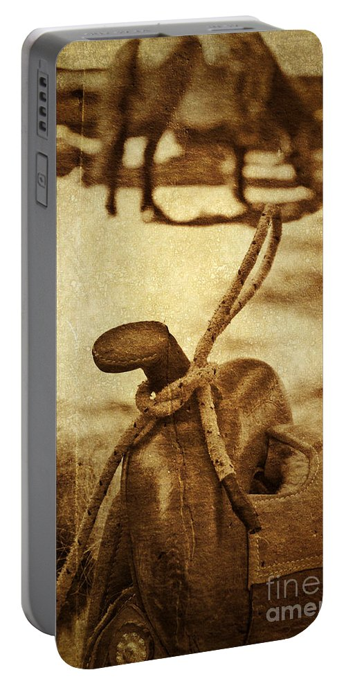 Saddle Portable Battery Charger featuring the photograph Saddle by Silvia Ganora