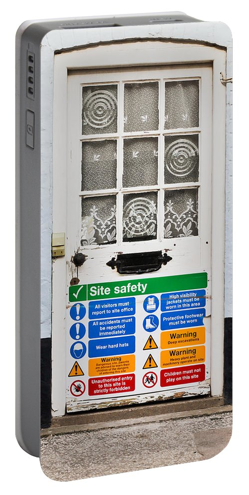 Building Portable Battery Charger featuring the photograph Safety Sign by Tom Gowanlock