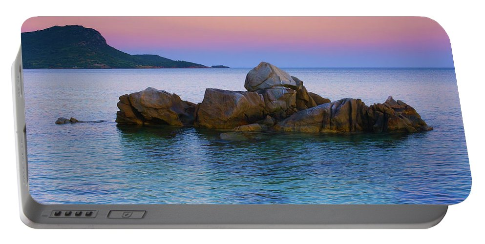 Sea Portable Battery Charger featuring the photograph Sand Rocks In The Sea At Sunset by Goran Kojadinovic