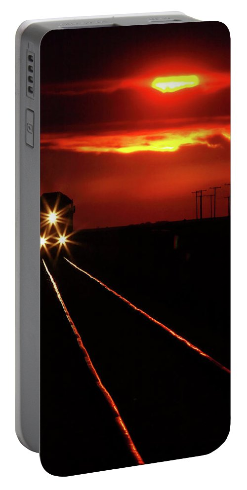 Sunset Portable Battery Charger featuring the digital art Scenic View Of An Approaching Trrain Near Sunset by Mark Duffy