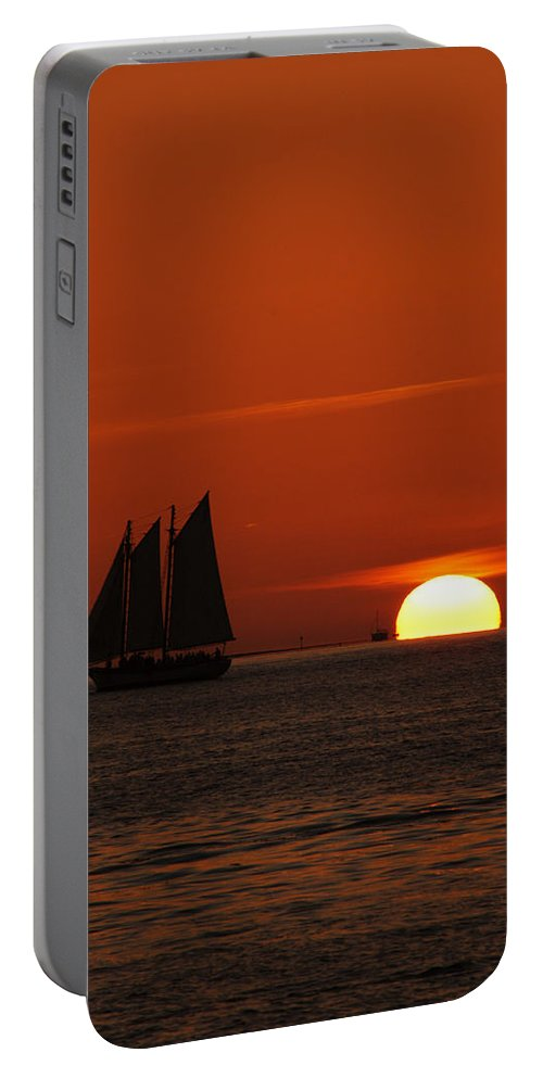 Schooner In Red Sunset Portable Battery Charger featuring the photograph Schooner In Red Sunset by Susanne Van Hulst
