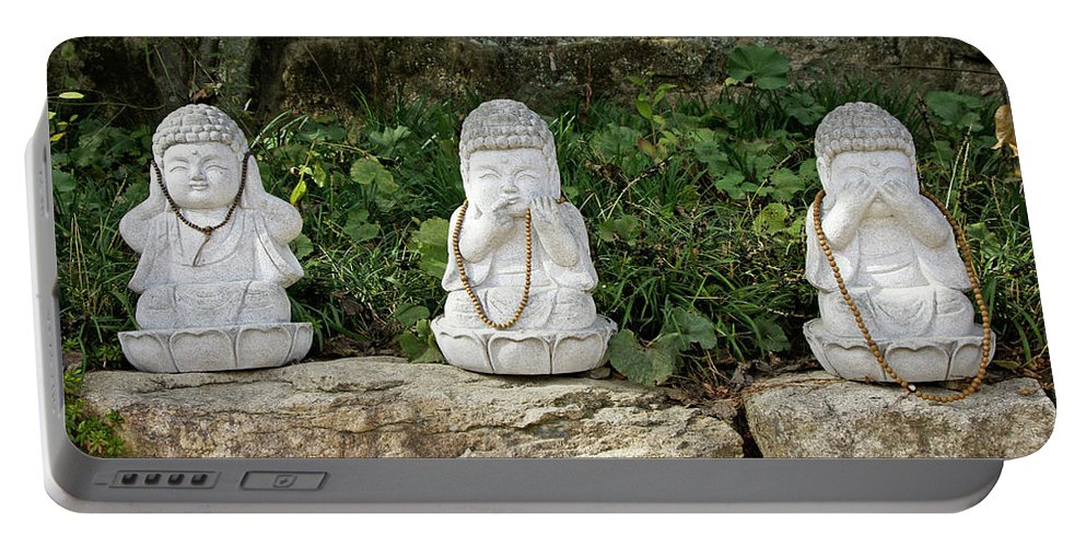 Asia Portable Battery Charger featuring the photograph See Hear Speak No Evil by Michele Burgess