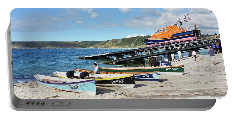Land\'s End Portable Battery Charger featuring the photograph Sennen Cove Lifeboat And Pilot Gigs by Terri Waters