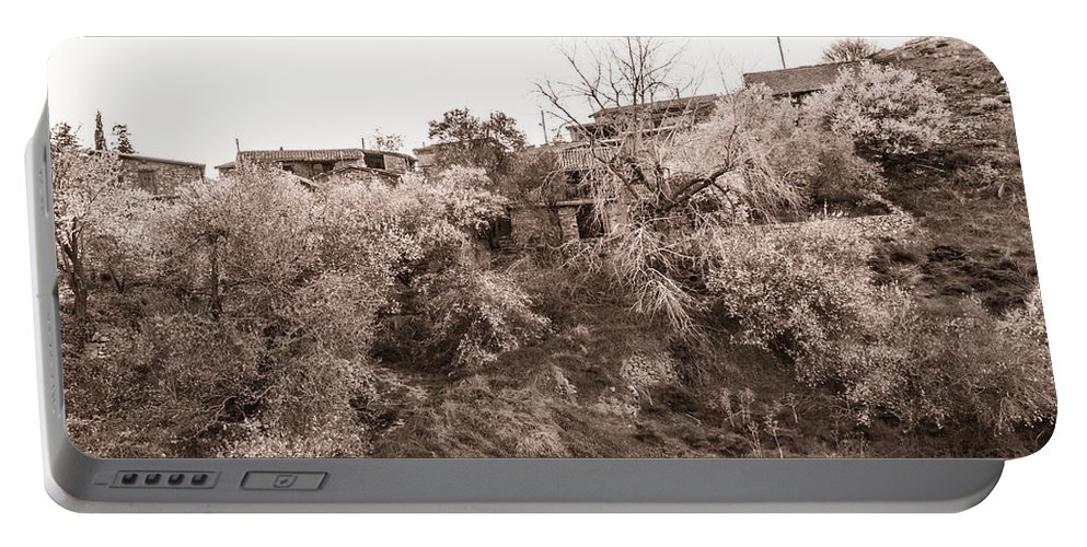 Cyprus Portable Battery Charger featuring the photograph Sepia-toned Blooming Almond Trees Of Fikardou Village 2 by Iordanis Pallikaras