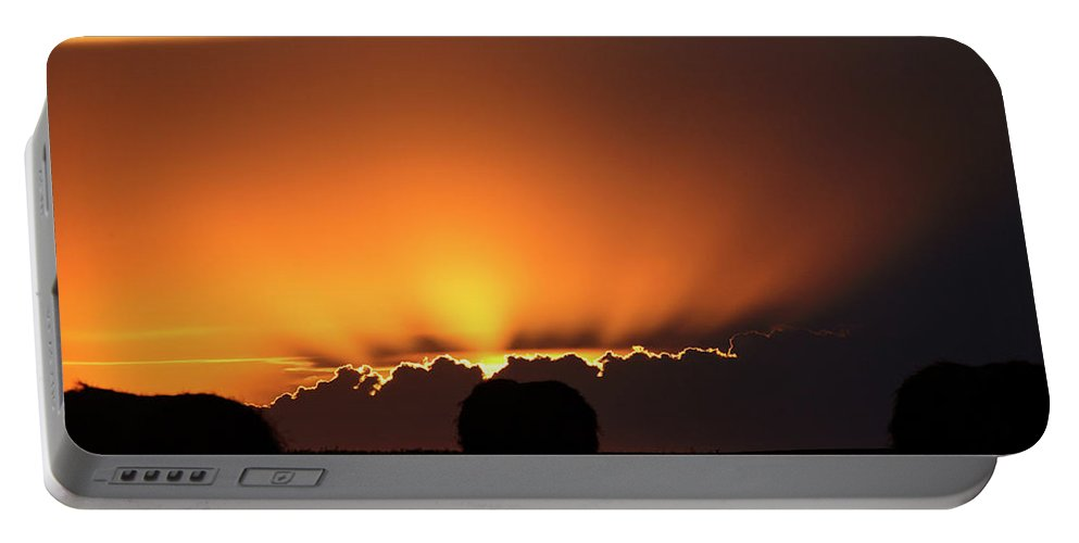 Sun Portable Battery Charger featuring the digital art Setting Sun Peaking Out From Storm Clouds In Saskatchewan by Mark Duffy
