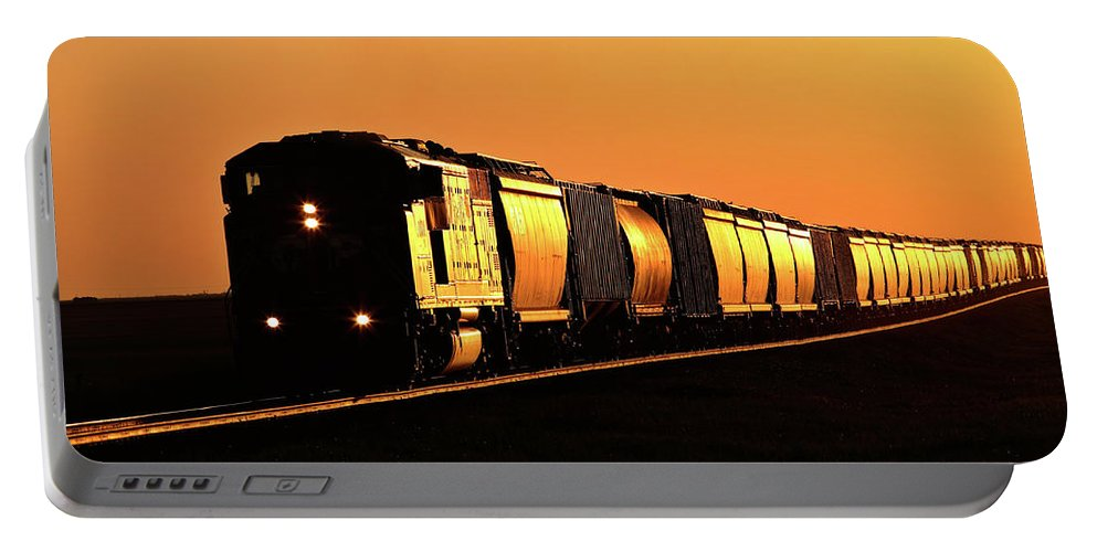 Sunlit Portable Battery Charger featuring the digital art Setting Sun Reflecting Off Train And Track by Mark Duffy