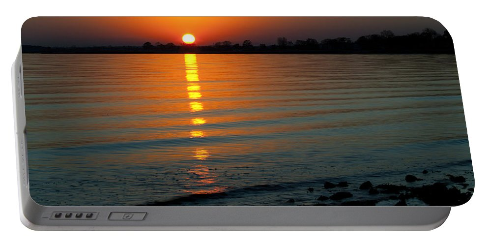 Sunset Portable Battery Charger featuring the photograph Settling Sun by Karol Livote