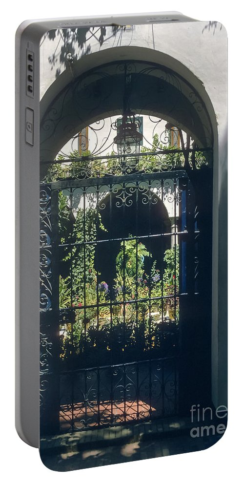 Seville Portable Battery Charger featuring the photograph Seville City Courtyard by Bob Phillips