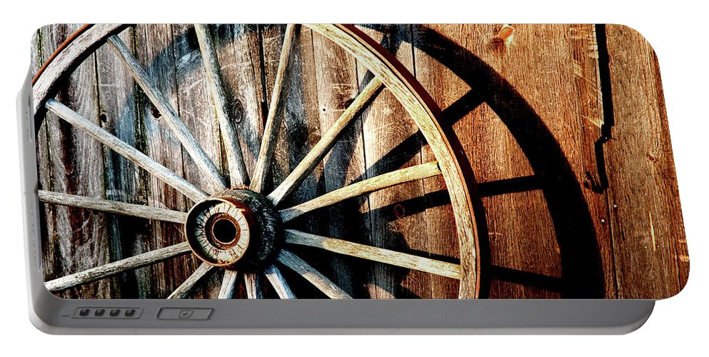 Wagon Wheel Portable Battery Charger featuring the photograph Shadows Of The Past by Greg Fortier