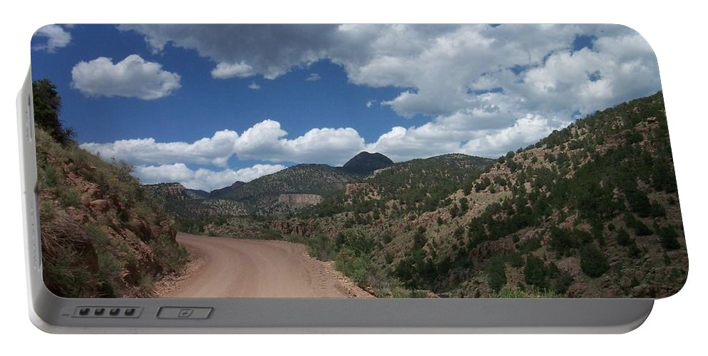 Shelf Road Portable Battery Charger featuring the photograph Shelf Road by Anita Burgermeister
