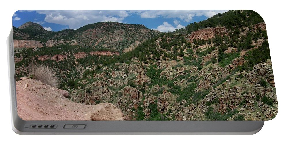 Shelf Road Portable Battery Charger featuring the photograph Shelf Road Drop Off by Anita Burgermeister