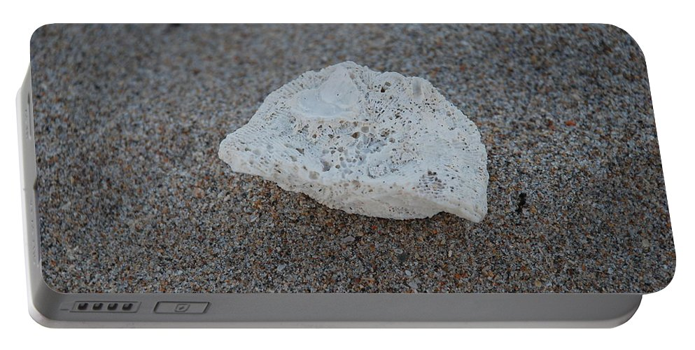 Shells Portable Battery Charger featuring the photograph Shell And Sand by Rob Hans