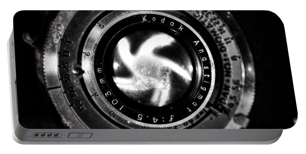 Kodak Portable Battery Charger featuring the photograph Shutters Vortex by Scott Wyatt
