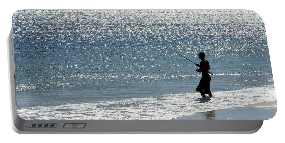 Fishing Portable Battery Charger featuring the photograph Silhouette Of A Man Fishing by Anthony Totah