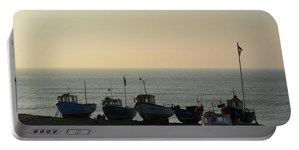 Silhouette Portable Battery Charger featuring the photograph Silhouette Of Boats On Beach by Andy Thompson