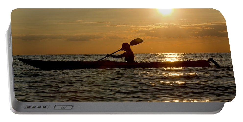 Athlete Portable Battery Charger featuring the photograph Silhouette Of Woman Kayaking In The Ocean. by Anthony Totah