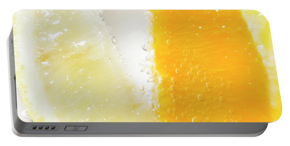 Closeup Portable Battery Charger featuring the photograph Slice Of Orange And Lemon In Cocktail Glass by Jorgo Photography - Wall Art Gallery