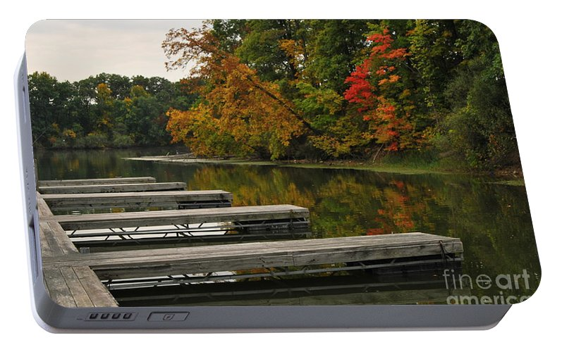 Boat Slipslips Portable Battery Charger featuring the photograph Slips In Autumn by Michelle Hastings